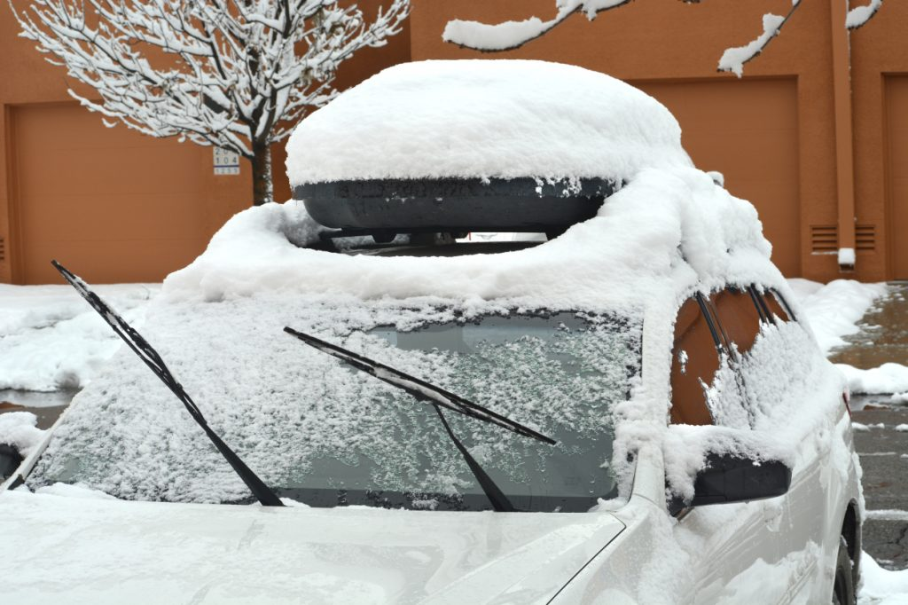 A car parked outside covered in snow