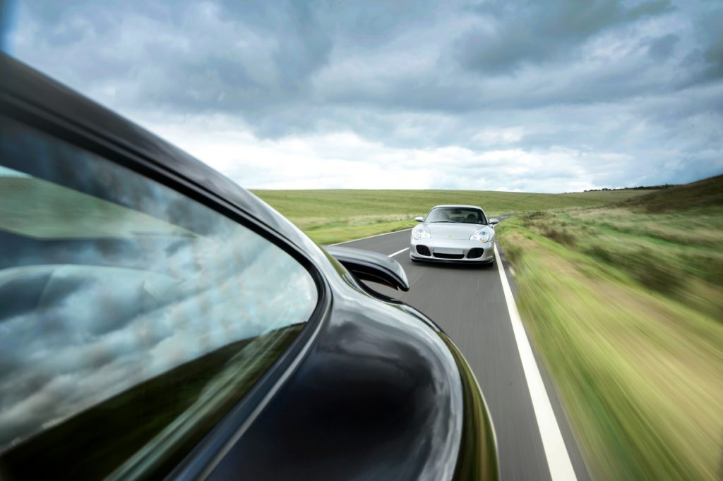 A car speeding down a highway