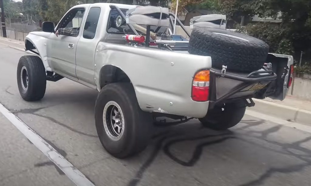The rear of a silver custom 1999 Toyota Tacoma Baja Pre-Runner pickup truck.