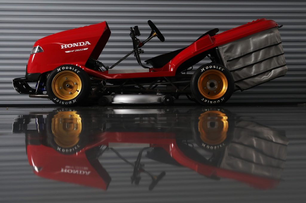 The side view of the red Honda Mean Mower V2