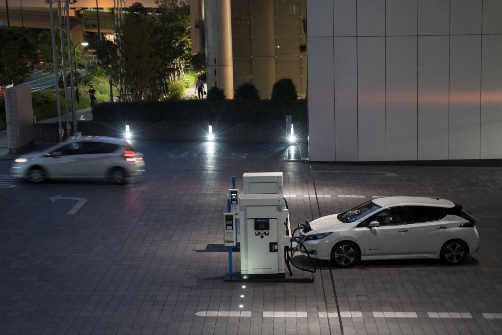 A Nissan Motor Co. Leaf electric vehicle is charged at the company's headquarters at night on May 27, 2020 in Yokohama, Japan