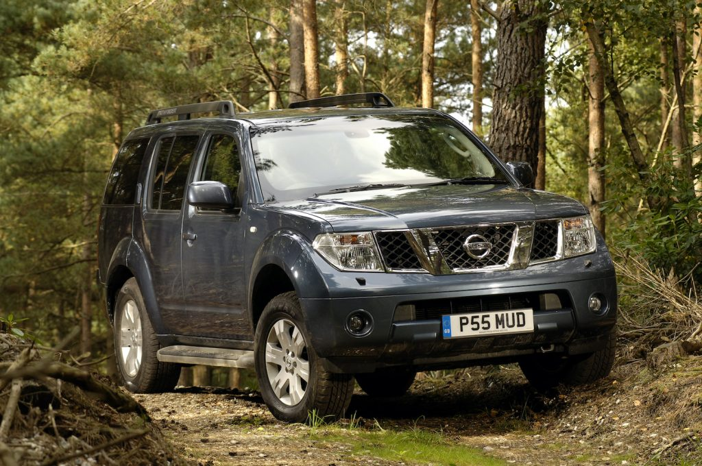 A 2005 Nissan Pathfinder in the woods