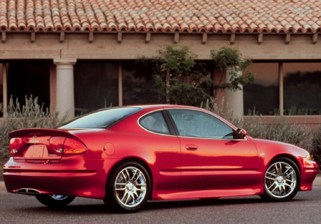 The rear 3/4 view of the red Oldsmobile Alero OSV