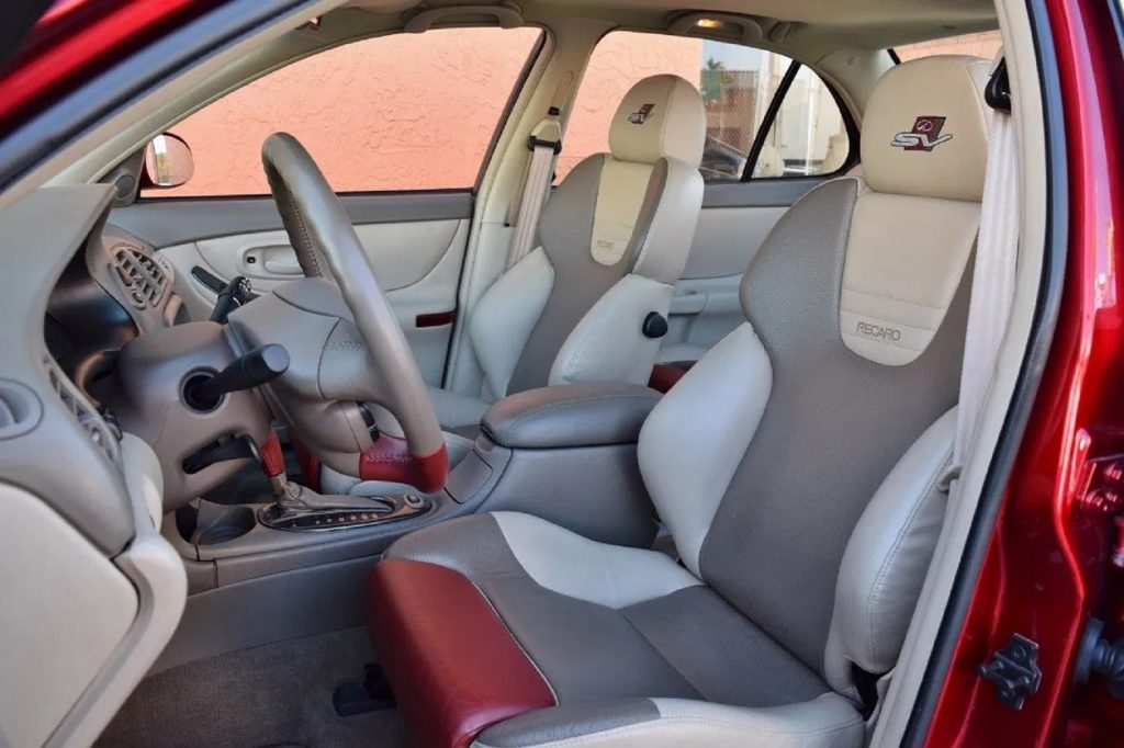 The tan-and-red leather interior of the Oldsmobile Intrigue OSV