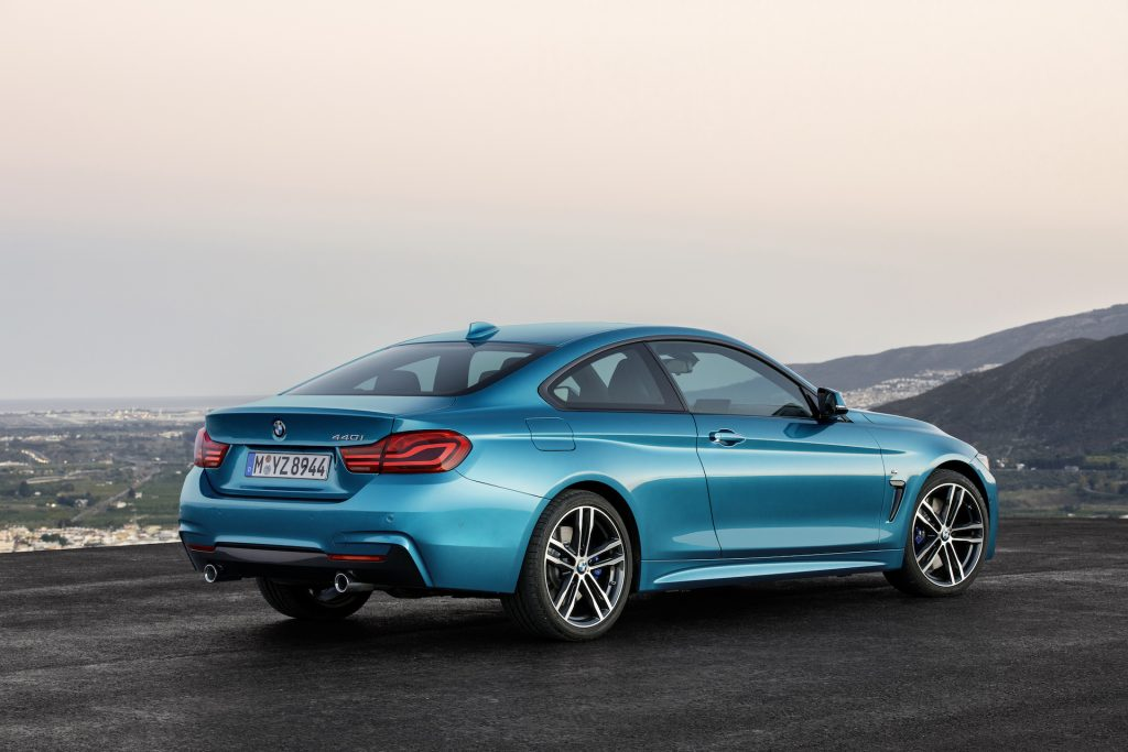 An image of a BMW 4 Series parked on the top of a mountain.