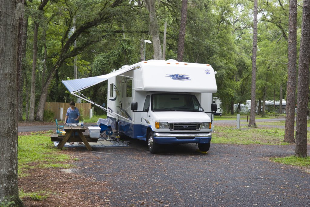 A Class C RV parked at a campground