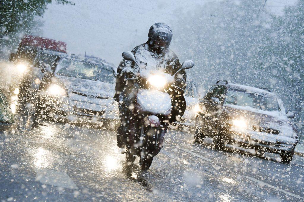 Riding a motorcycle through a winter snowstorm