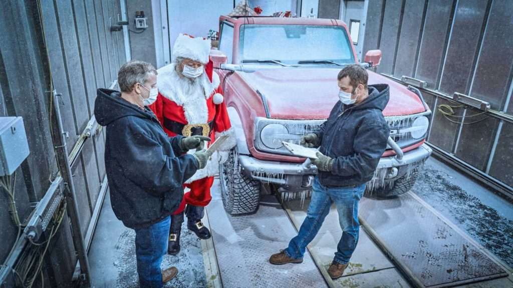 Ford stands with two engineers discussing the 2021 Ford Bronco's cold weather testing results. | Ford Motor Company