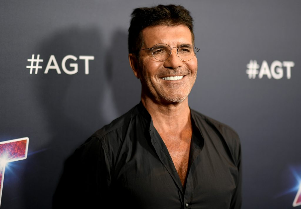 Simon Cowell smiles for a photo opportunity.