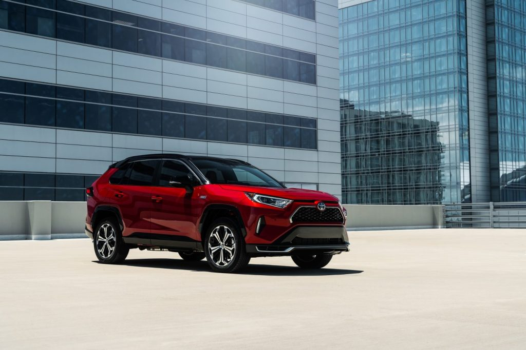 An image of the 2021 Toyota RAV4 Prime parked on the top of a building.