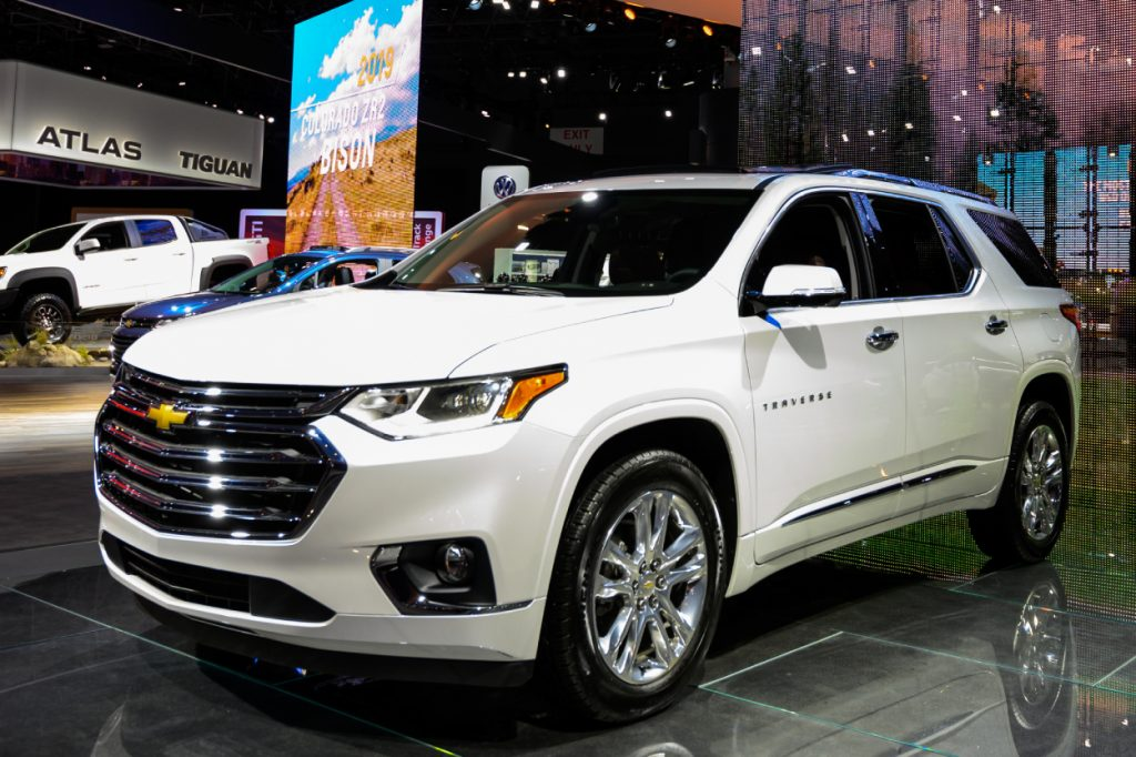 A white Chevy Traverse SUV on display at an auto show