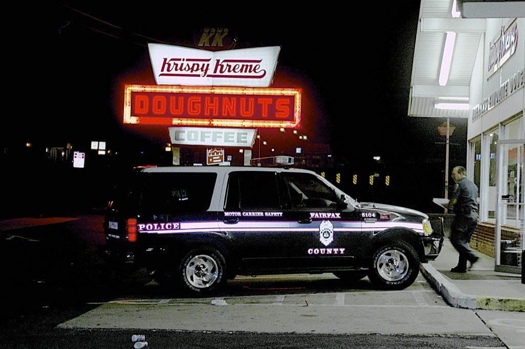cop car parked outside a krispy kreme