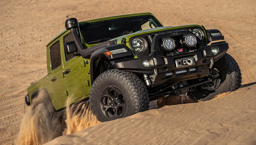 AEV Jeep Gladiator driving up sand mounds