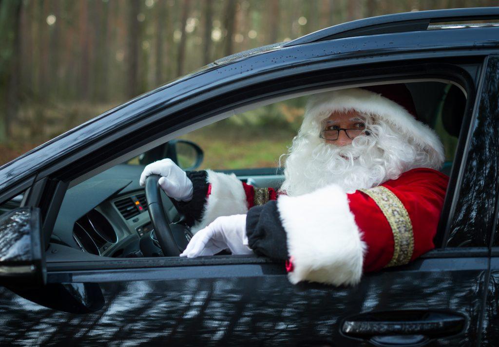 Santa Claus sits in a car