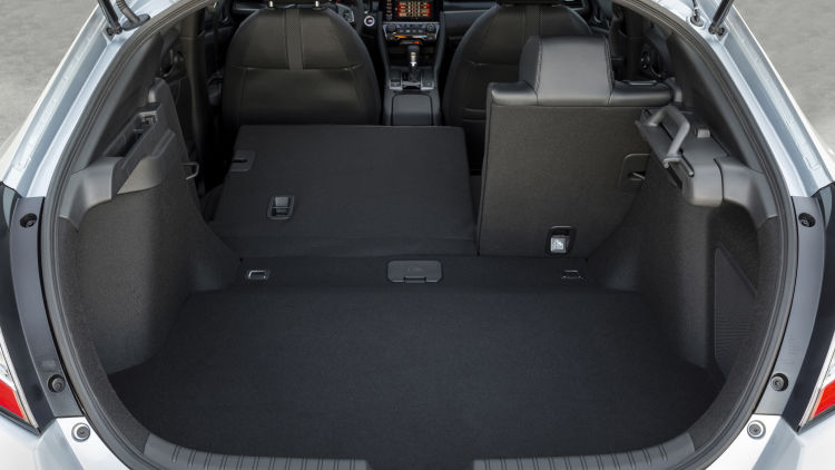 A 2021 Civic Hatchback with the rear seats folded down.