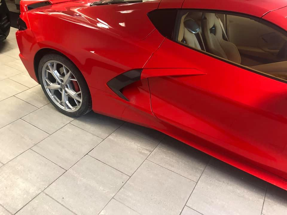 An image of a Chevy Corvette C8 at a dealership.