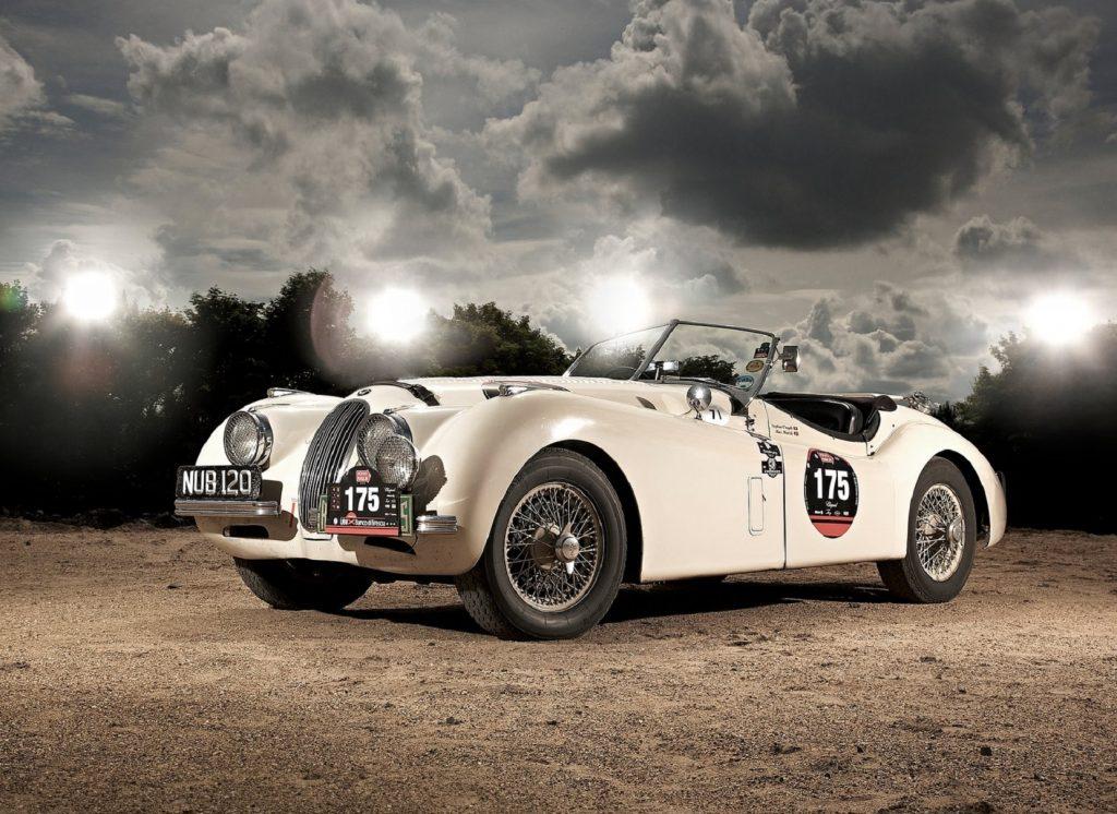 A white 1948 Jaguar XK120 race car