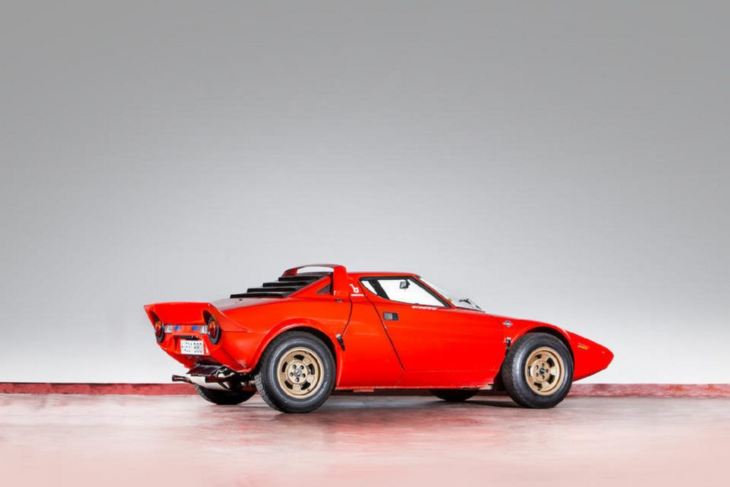 The rear 3/4 view of a red 1974 Lancia Stratos HF Stradale