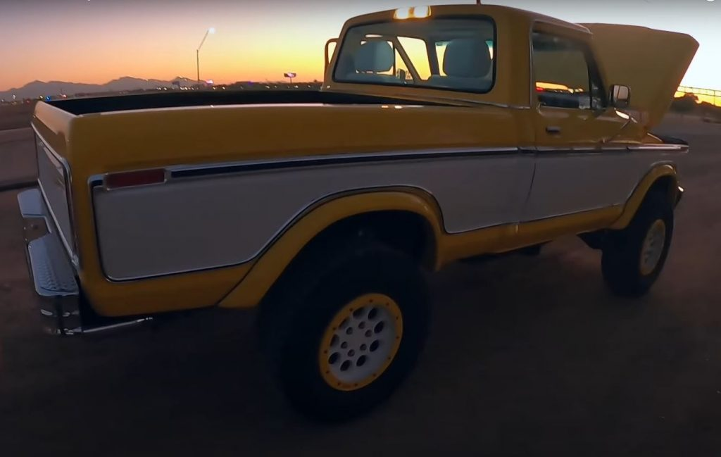 The rear passenger side of a yellow and white 1979 Ford F-150 Raptor restomod by Sweet Brothers