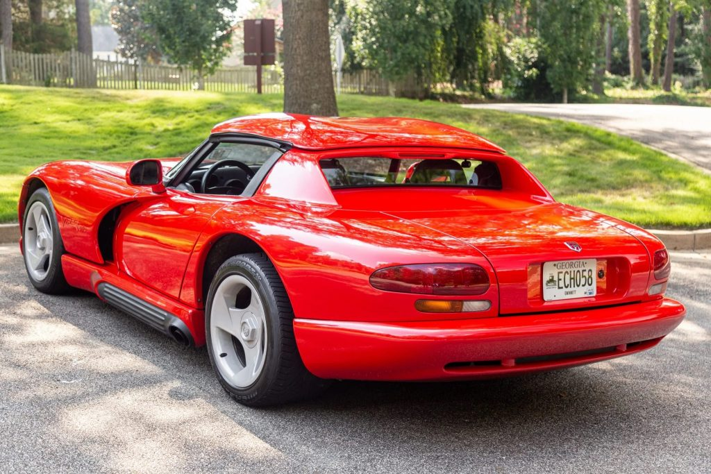 The rear 3/4 view of a red 1993 Dodge Viper RT/10 with a hardtop