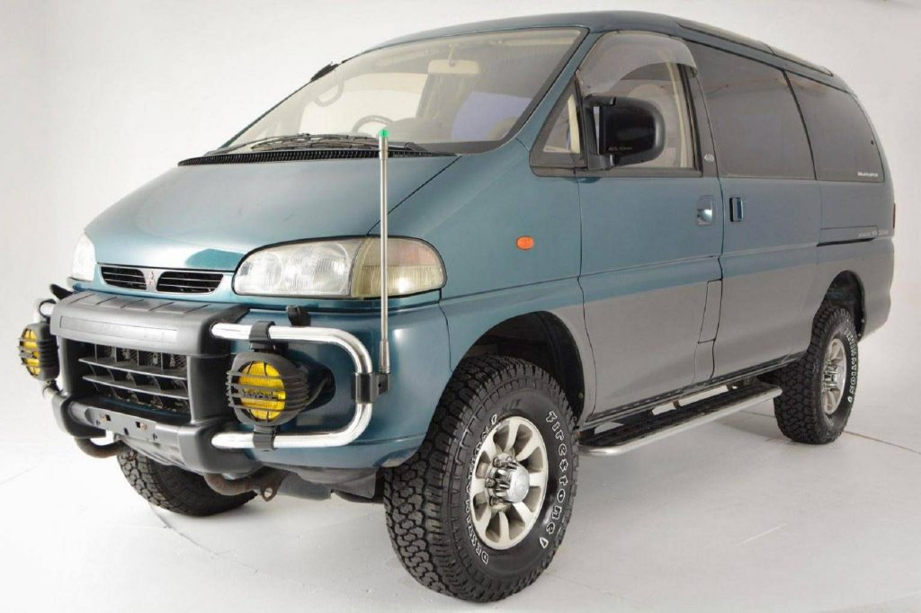 A turquoise 1994 Mitsubishi Delica Space Gear LWB 4x4