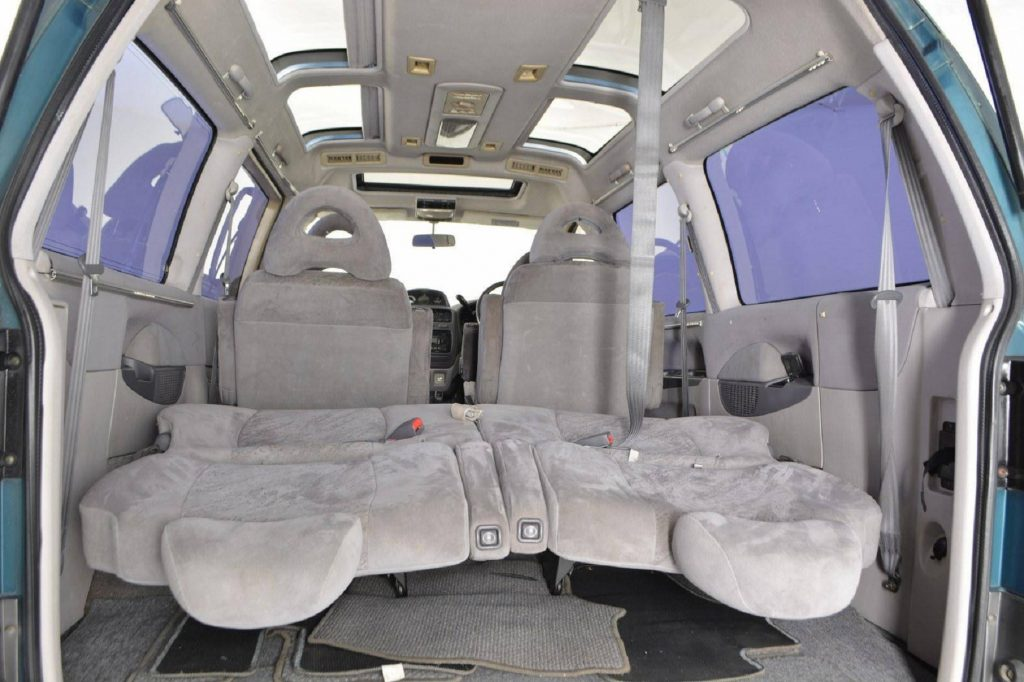 The interior of a 1994 Mitsubishi Delica Space Gear LWB 4x4 interior seen from the rear with the 3rd-row seats folded