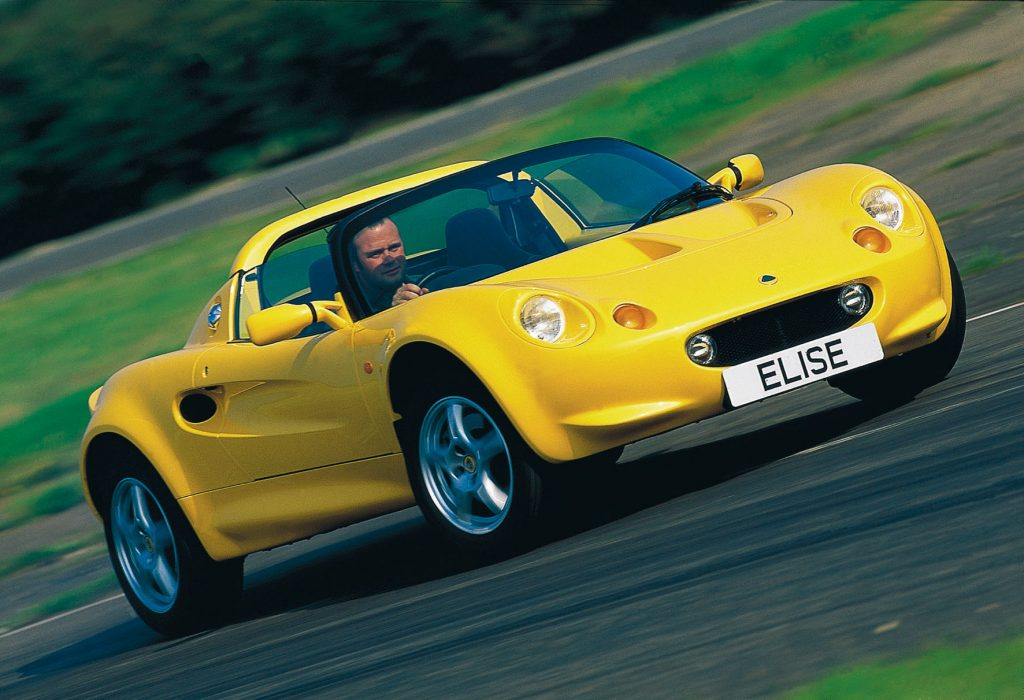 A yellow 1996 Lotus Elise S1 on a racetrack