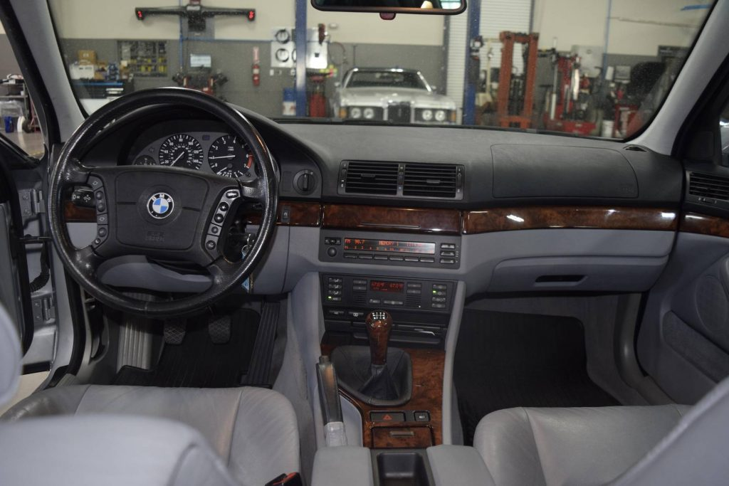 The gray-leather front seats and walnut-trimmed dashboard of a 1997 BMW 540i