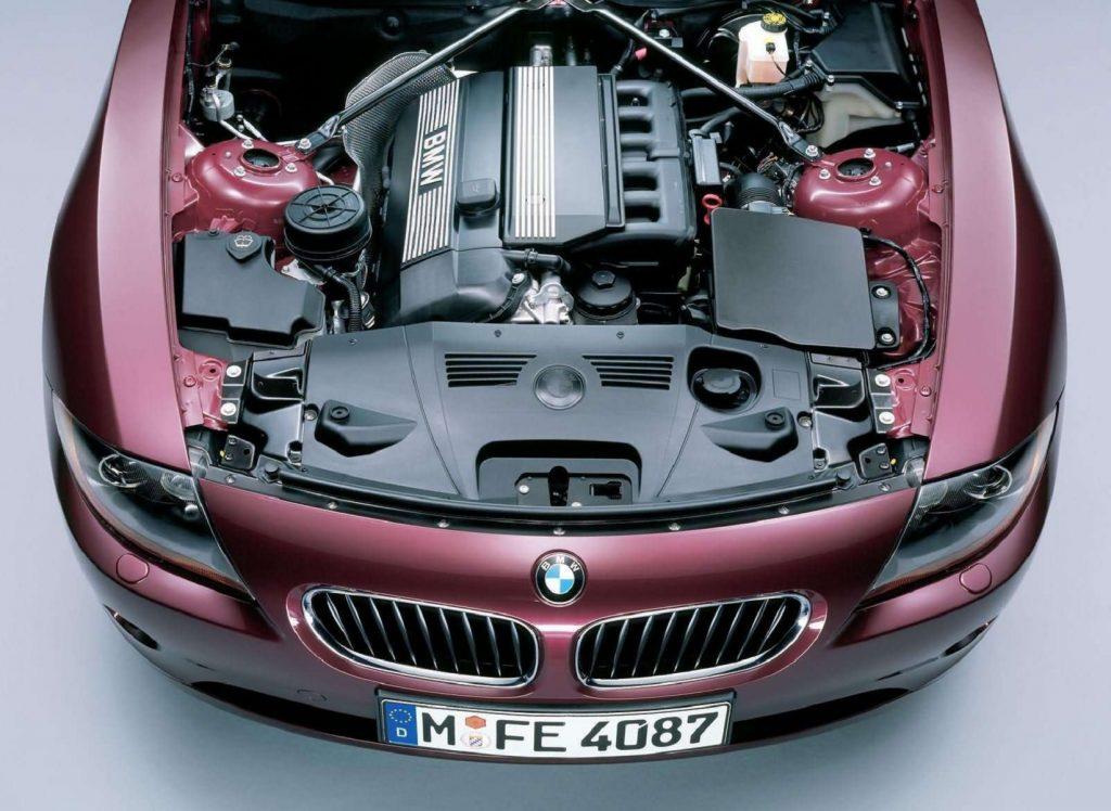 A burgundy 2004 BMW Z4 showing its M54 inline-6 engine