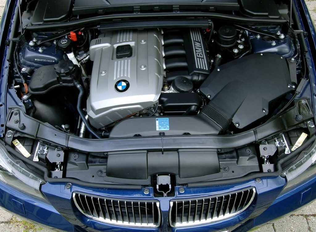 The N52 engine in the bay of a blue 2006 E90 BMW 325i Touring
