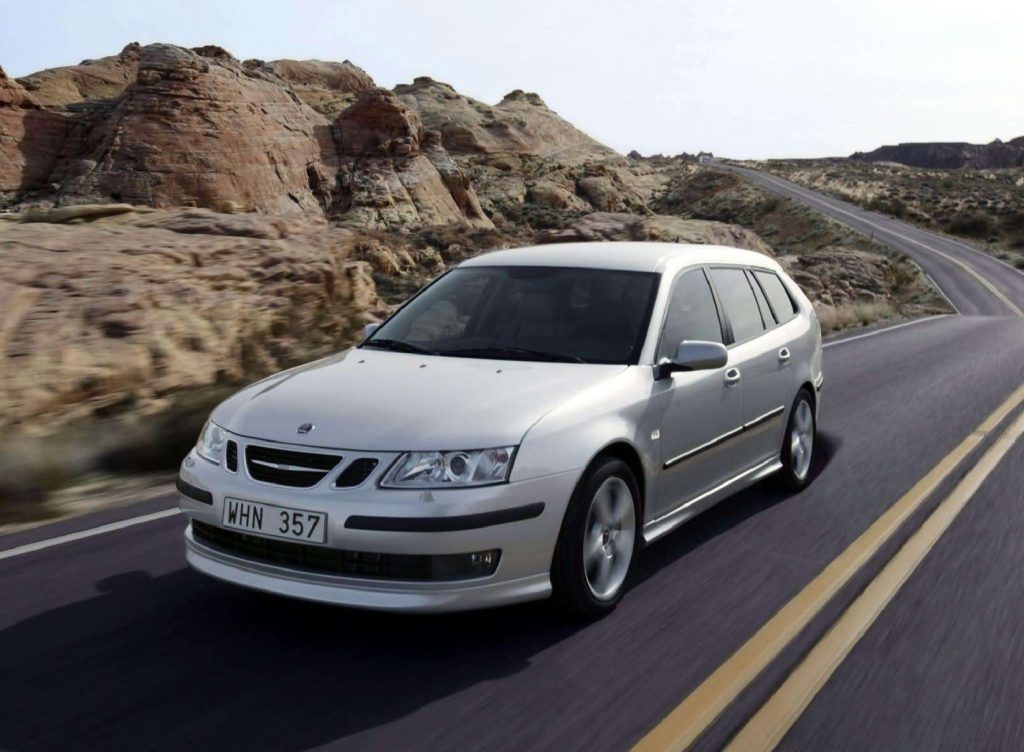 A silver 2006 Saab 9-3 SportCombi on a desert road