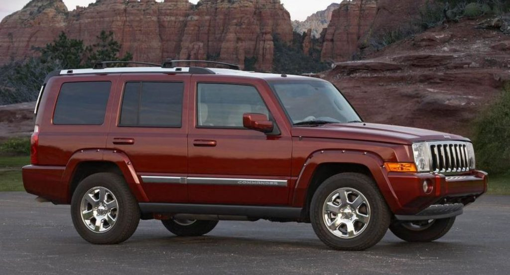 A burgundy 2008 Jeep Commander at the base of the Grand Canyon.