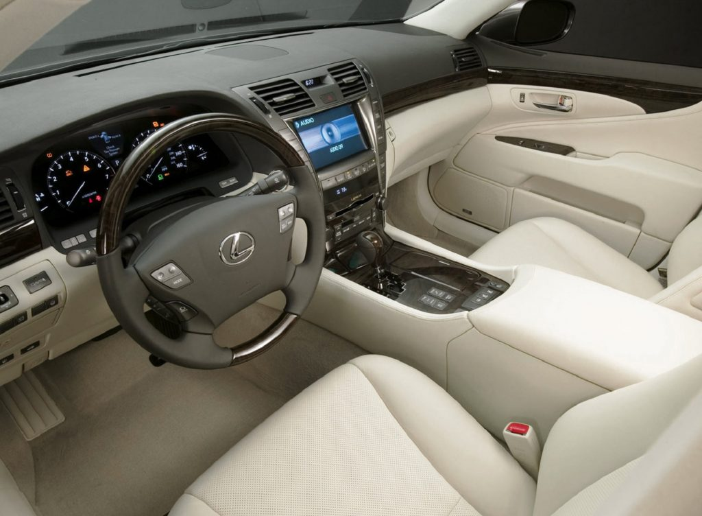 The tan-leather front seats and wood-trimmed dashboard of the 2009 Lexus LS 460