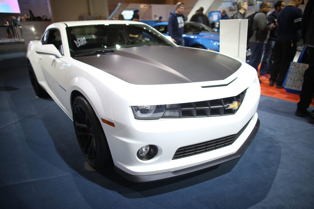 A 2013 Chevy Camaro on display at an auto show