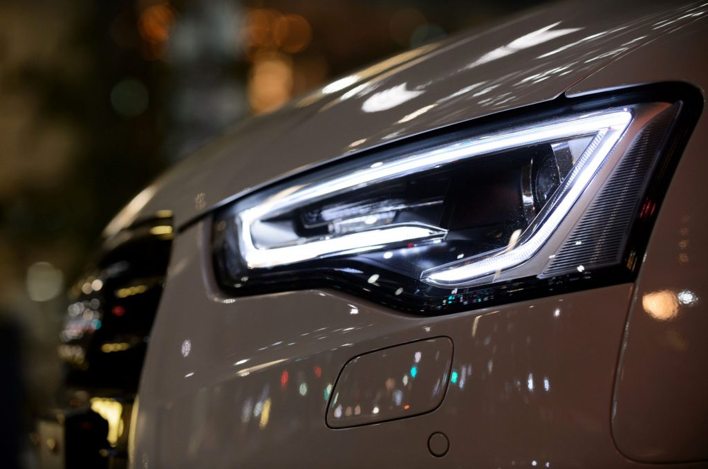 A close-up of a white 2015 Audi A5 Cabriolet's LED headlight