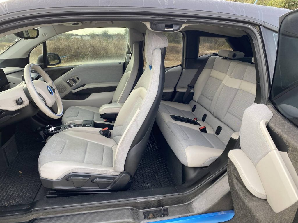 The tan-and-gray interior of a 2015 BMW i3 REX