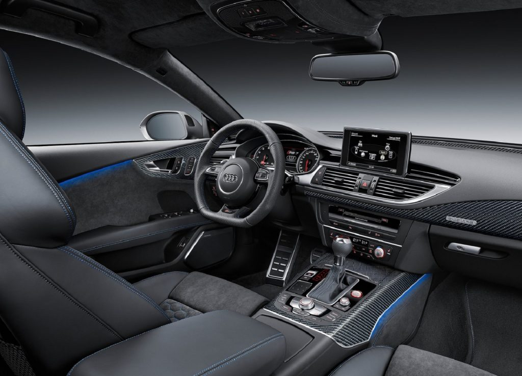 The blue-stitched black front seats and carbon-fiber-trimmed dashboard of the 2016 Audi RS7 Performance