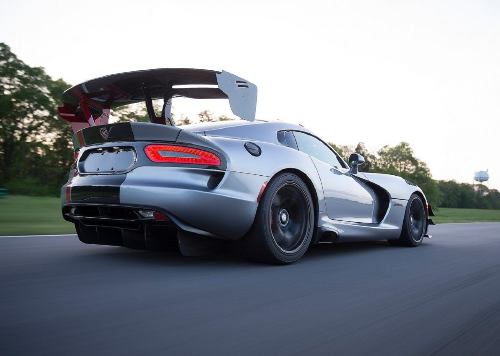 The low-angle rear 3/4 view of a silver 2016 Dodge Viper ACR and its wing