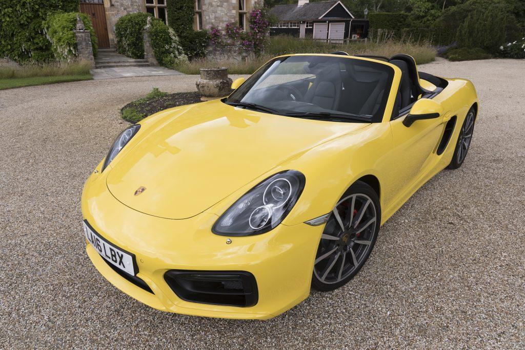 A yellow 2016 Porsche Boxster S
