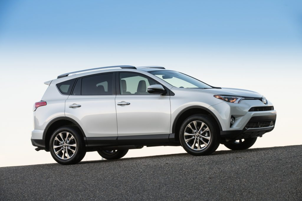 A silver 2017 Toyota RAV4 parked on display in front of a blue sky
