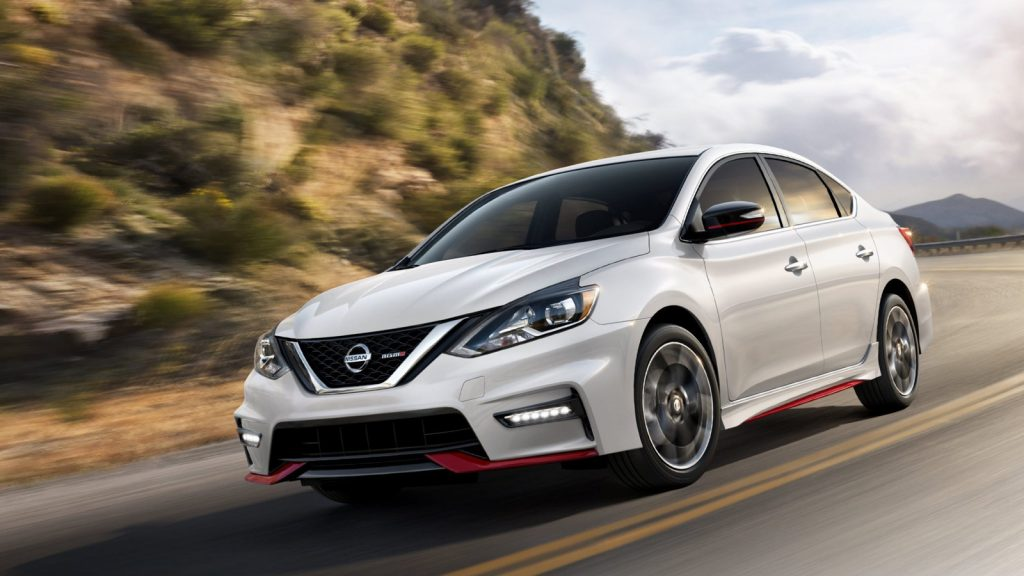 A white 2018 Nissan Sentra on the track.