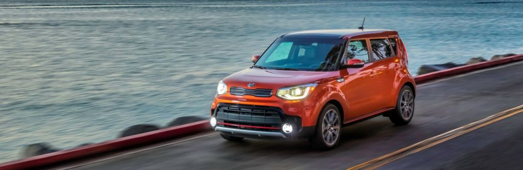 An orange 2019 Kia Soul on the track.