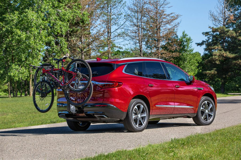 A red 2020 Buick Enclave with a bike attatched to the rear hatch