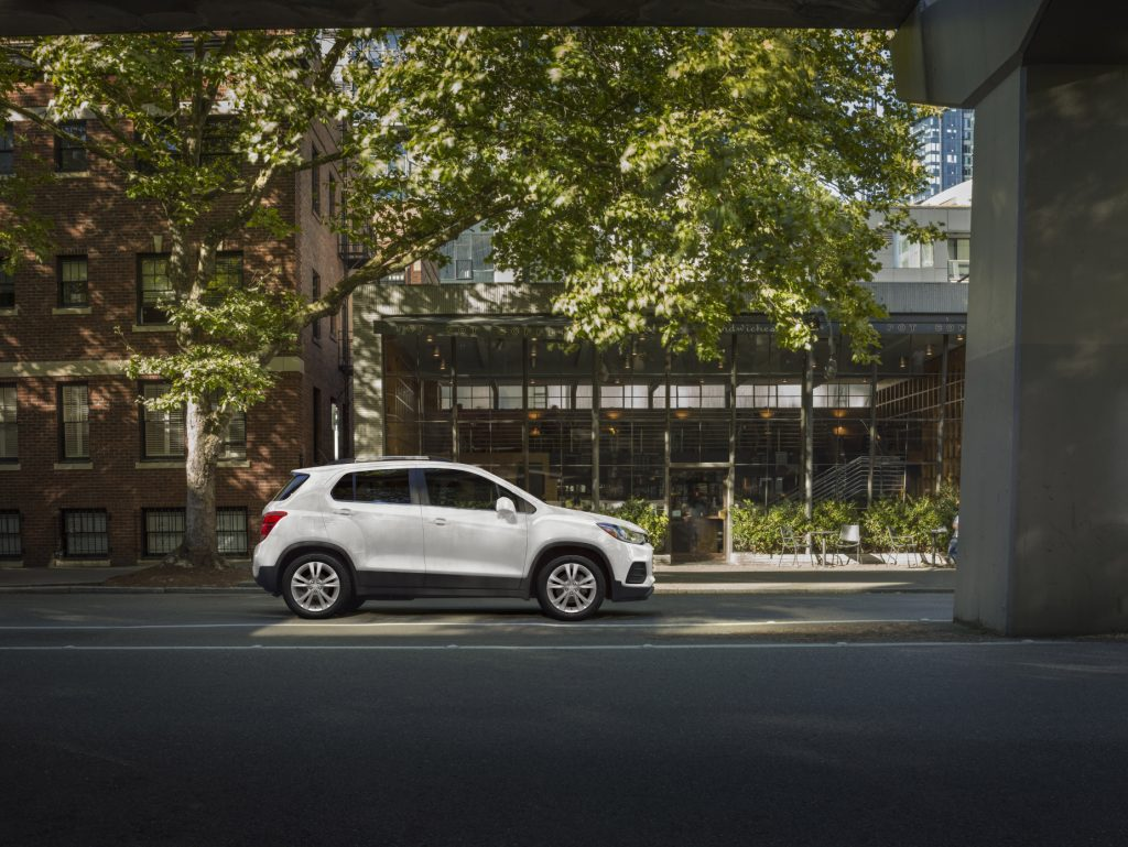 A white 2020 Chevrolet Trax subcompact SUV parked next to a building