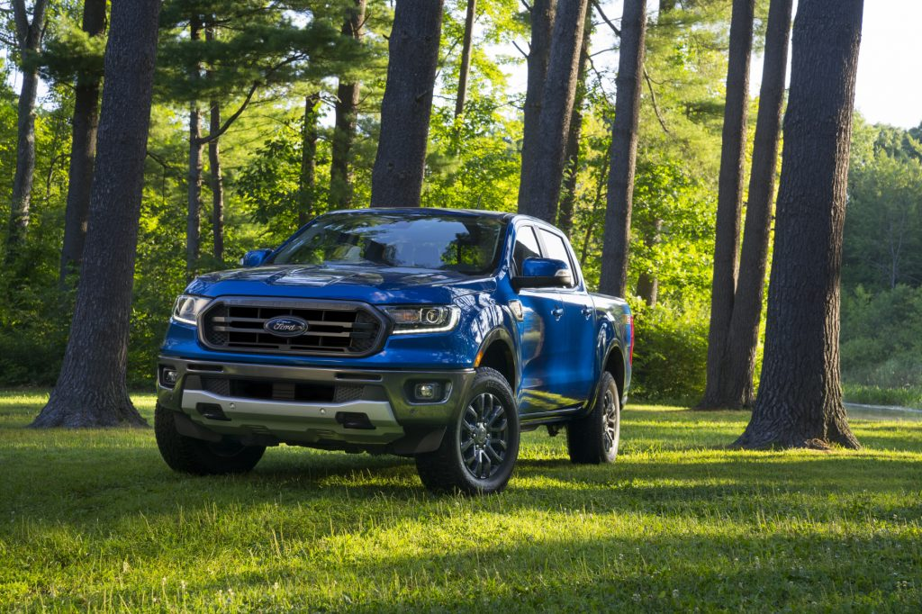 A blue 2020-2021 Ford Ranger parked in the woods