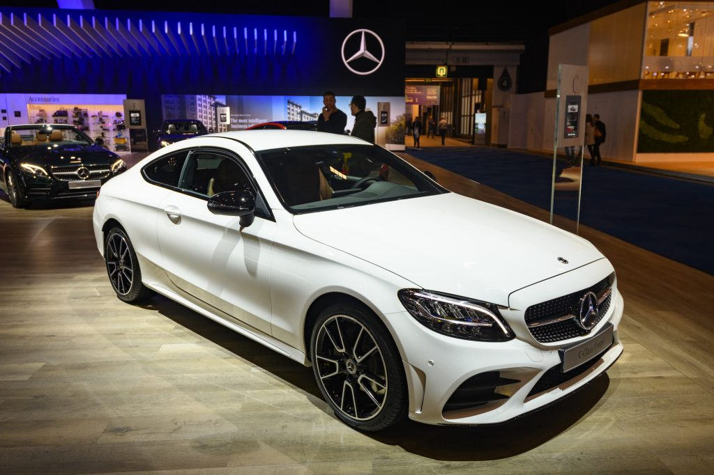 A white 2020 Mercedes-Benz C-Class Coupe on display at Brussels Expo on January 9, 2020, in Brussels, Belgium.