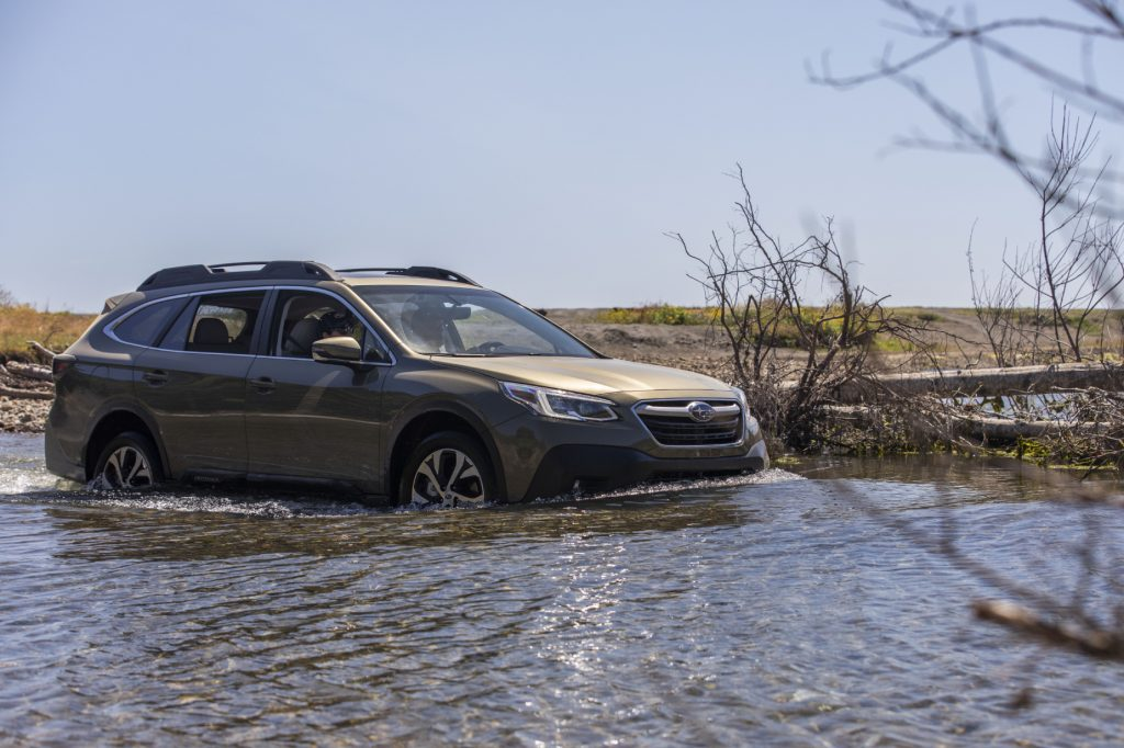 A 2020 Subaru Outback with AWD driving through water