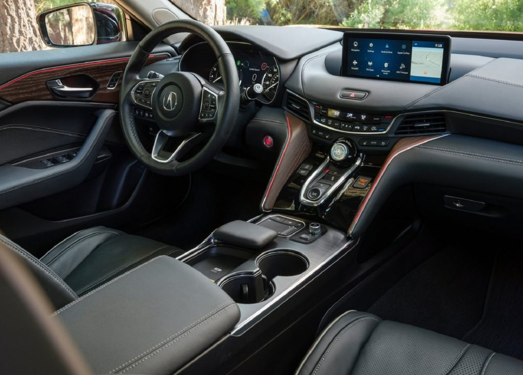 The black-leather-upholstered front seats and dashboard of the 2021 Acura TLX Advance Package