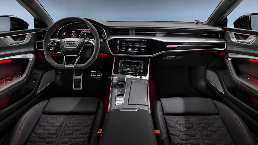 The red-stitched black seats and carbon-fiber-trimmed dashboard of the 2021 Audi RS7