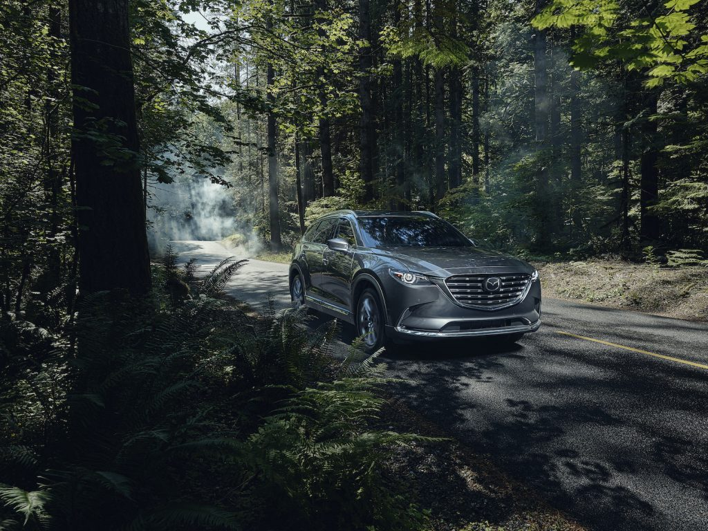 2021 Mazda CX-9 driving through the woods